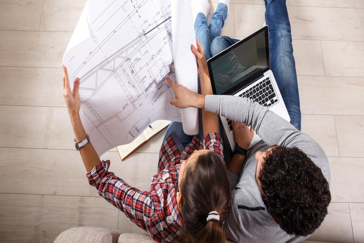 Couple looking at apartment plans