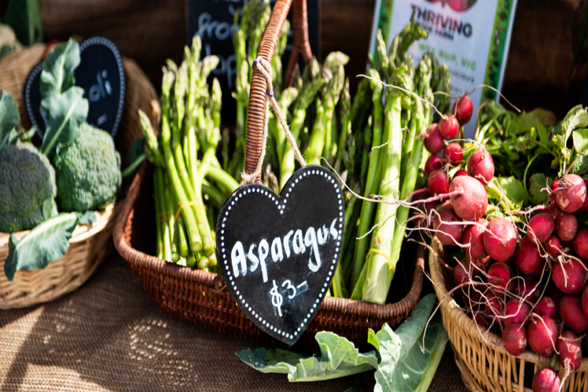 Close up showing asparagus in basket at Alphington Farmers Market